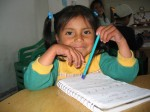 little girl undertaking school tutoring