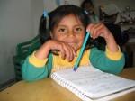 little girl undertaking school tutoring